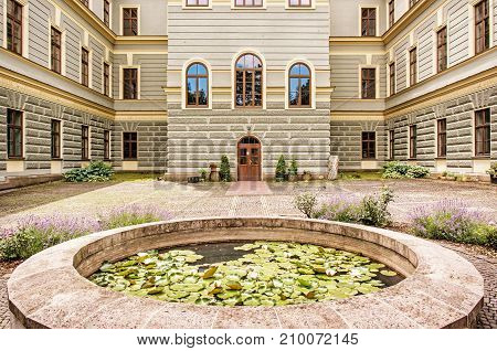 Courtyard of the forestry school in old mining town Banska Stiavnica Slovak republic. Travel destination. Yellow photo filter.