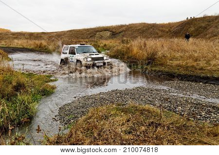 Rally 4Wd Suv Car Overcomes Water Obstacle.