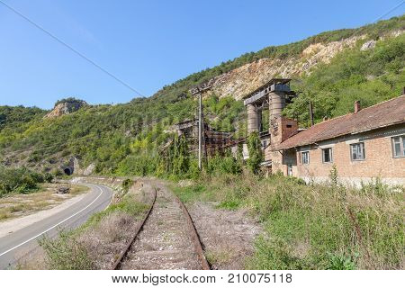 Abandoned mine - quarry near an abandoned railway line in Kucevo eastern Serbia. Buildings and industrial installations are left to decay