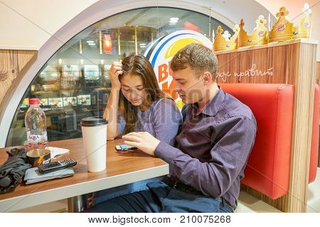 SAINT PETERSBURG, RUSSIA - CIRCA OCTOBER, 2017: couple at Burger King restaurant. Burger King is an American global chain of hamburger fast food restaurants.
