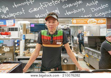 SAINT PETERSBURG - CIRCA OCTOBER, 2017: indoor portrait of worker at Burger King restaurant. Burger King is an American global chain of hamburger fast food restaurants.