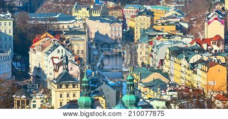 Karlovy Vary, Czech Republic - February 15, 2017: Aerial street view, houses and river in famous spa town