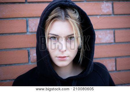 Alone Girl Portrait With Hooded Sweatshirt Next Urban Street Wall