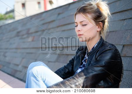 Young Girl Feeling Bad In The City Street