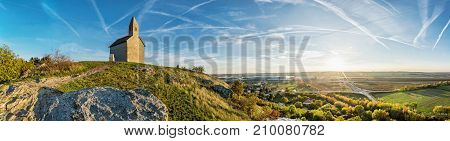 Romanesque church Saint Michael Drazovce village and industrial park Nitra - North in sunset Slovak republic. Autumn panoramic scene. Landscape in middle Europe.