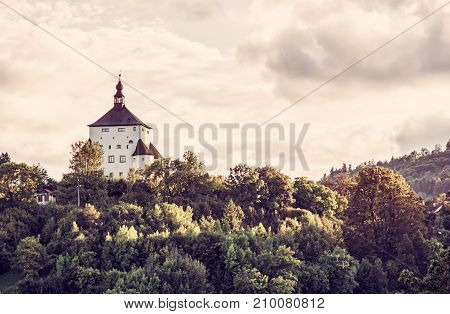 New Castle with forest in sunset Banska Stiavnica Slovak republic. Travel destination. Cultural heritage. Red photo filter.