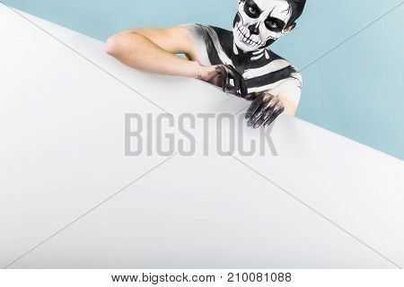 Beautiful Girl With Skeleton Makeup Over The Copy Space