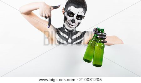 Attractive Girl With Skeleton Makeup Hold Green Glass Bottle