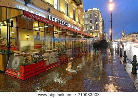 06.10.2017.Russia.Saint-Petersburg.Nevsky Prospekt in the evening.On the street burning electric lamps.On the walls are glowing title bars .