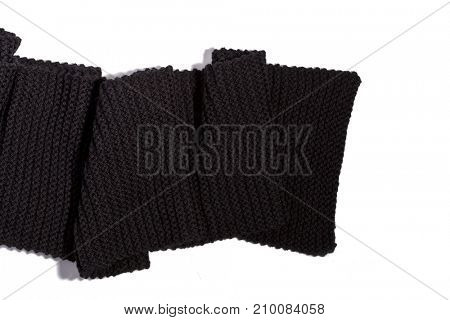 knitted black scarf isolated on white background