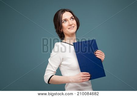 Picture Of Good Looking Woman In Light Clothes Standing With Recordings In Hands
