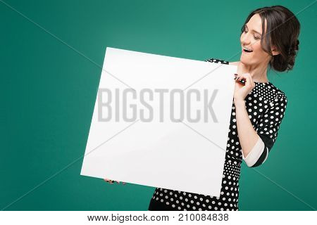 Image Of Beautiful Woman In Speckled Clothes Standing With Paper In Hands