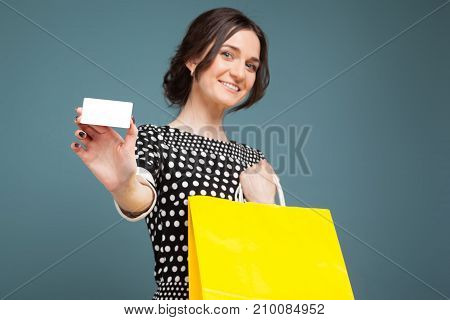 Image Of Good Looking Woman In Speckled Clothes Standing With Purchases And Cutaway In Hands