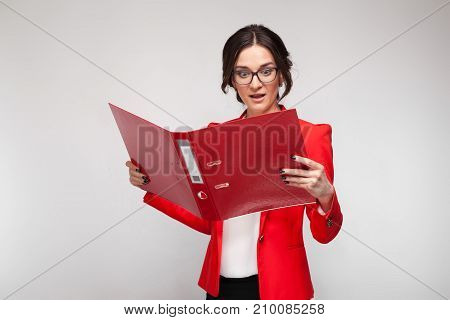 Picture Of Beautiful Woman In Red Blazer Standing With Documents In Hands