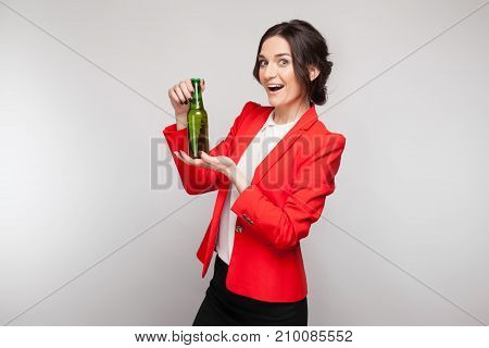 Picture Of Attractive Woman In Red Dress With Green Beer In Hands