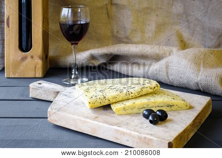 Homemade Haloumi Cheese On Wooden Board With Olives