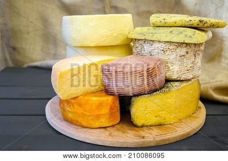 Cheese Collection Shropshire, Kachotta, Halumi, Maasdam On A Wooden Board