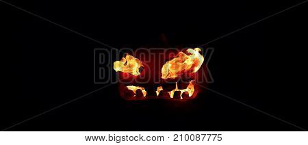 The Concept Of Halloween. The Evil Terrible Pumpkin Spews The Hellish Flames. Jack Lantern