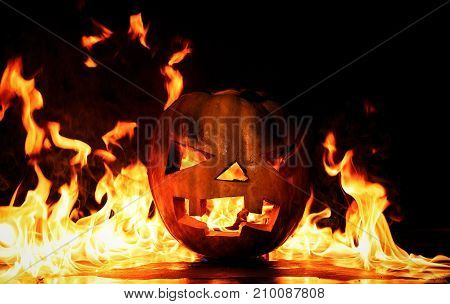 The Concept Of Halloween. The Evil Terrible Pumpkin Is Burning In The Hellish Tongues Of Flame. Jack