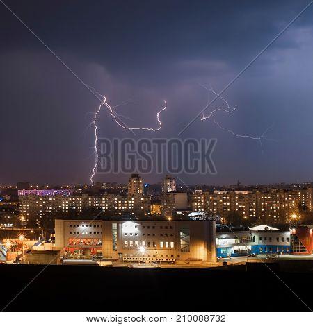 Lightning strike in the city houses in night