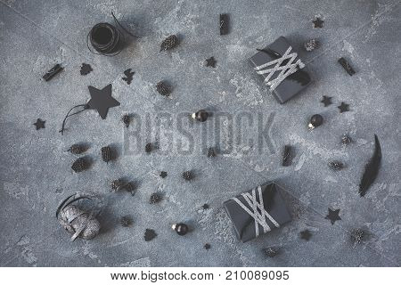 Christmas composition. Christmas gifts black decorations on black background. Flat lay top view