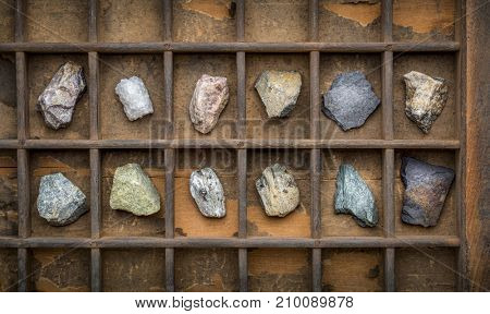 metamorphic rock geology collection in old, wooden typesetter box