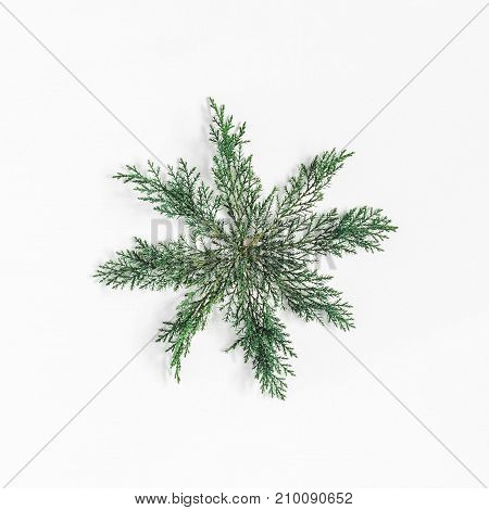 Christmas composition. Snowflake made of pine branches. Christmas winter new year concept. Flat lay top view