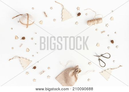 Christmas composition. Christmas gifts pine cones wooden decorations on white background. Flat lay top view copy space