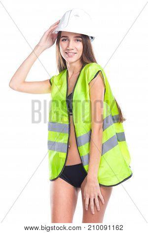 Attractive Young Brunette Woman In Builder Vest, Helmet And Black Bikini