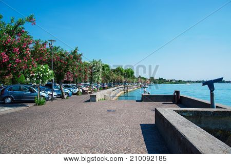 Quay in the town of Sirmione on Lake Garda. Italy.