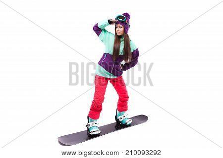 Pretty Young Woman In Purple Ski Suit Rides Black Snowboard