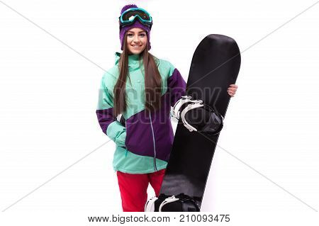 Young Woman In Purple Ski Outfit Hold Snowboard