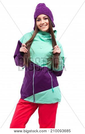 Young Woman In Purple Ski Suit