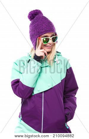 Beautiful Young Blonde Woman In Colorful Snow Coat