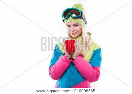 Cute Woman In Ski Suit With Red Cup