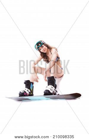 Pretty Sexy Woman In Pink Bikini And Sunglasses Sit In Snowboard Boots