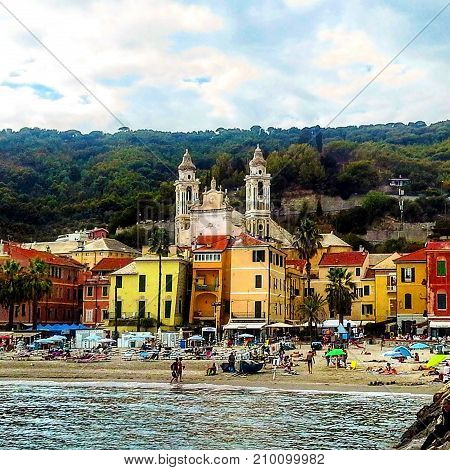 Laigueglia, Liguria, Italy: scenic view from the sea of colorful ligurian town, alleys and streets to the historic center of the village