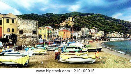 Fishing boats on the beach of Laigueglia Savona Liguria Ligurian Sea Italy.