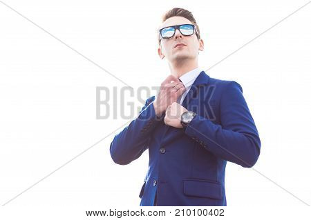 Young Busunessman In Blue Suit And Sunglasses Stand On The Roof