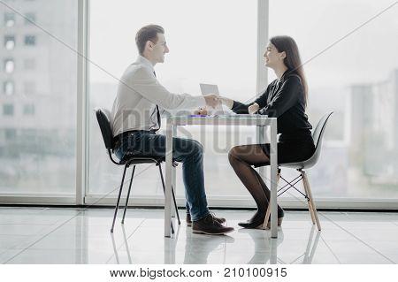 Handshake After Meetup. Business People Handshake In Bright Office Against Windows.