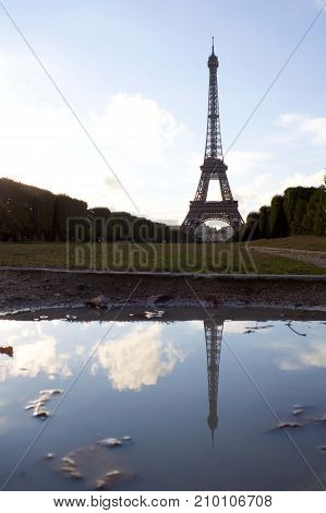 Silhouette Of The Eiffel Tower In A Puddle In Paris, France