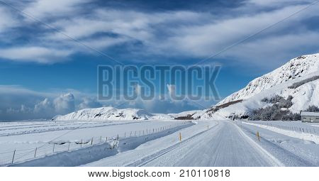 Highway 1 Iceland. Clear road covered in snow and ice under a deep blue sky