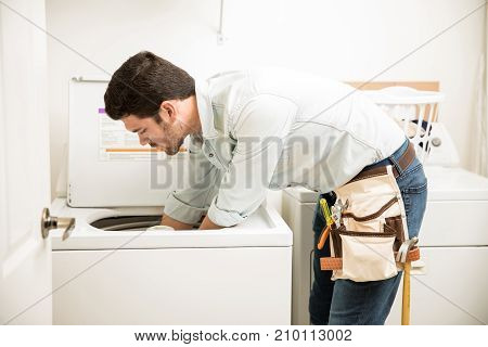 Technician Repairing A Washer