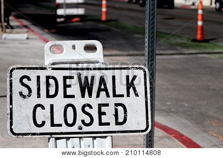 Sidewalk closed sign board closing a sidewalk