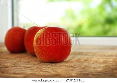 Fresh apples on windowsill