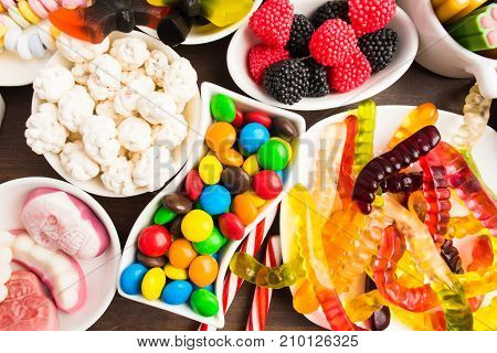Colorful Candies Over Brown Wooden Background