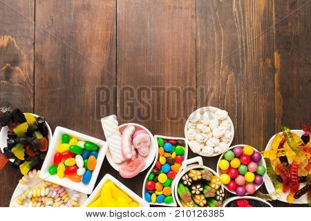 Sweet Candies Food Like Unhealthy Concept Over Brown Wooden Table