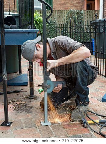 Worker Grinding Weld