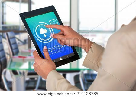 Businesswoman using digital tablet against update text with download symbol