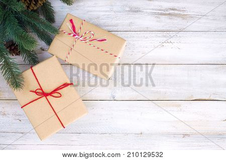 Christmas background - Christmas present gifts box and decorating elements on white  wooden background with snowflake. Creative Flat layout and top view composition with border and copy space design.